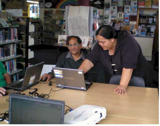 Honey Robinson, Stepping UP tutor, helping a student at the Taita Community Library in Hutt City